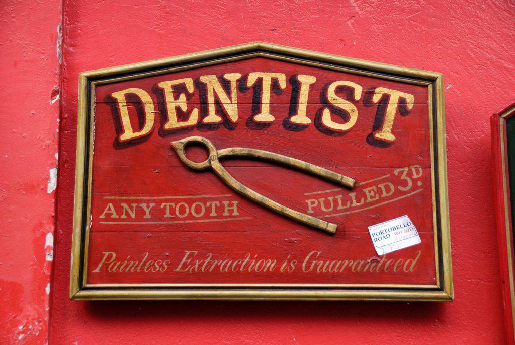 Stock Photo: 4282-32626 England, London, Portobello Road. An antique dentist sign for sale in Portobello market.