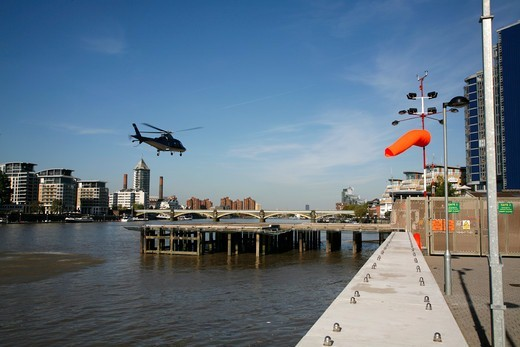 England, London, Battersea Heliport. Helicopter landing at Battersea Heliport. : Stock Photo