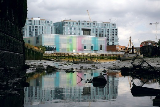 Stock Photo: 4282-32768 England, London, Deptford. A view along Deptford Creek at low tide to the Trinity Laban Conservatoire of Music and Dance in Deptford.