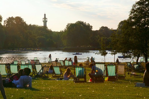 England, London, Regents Park. People relaxing in deck chairs in regents Park. : Stock Photo