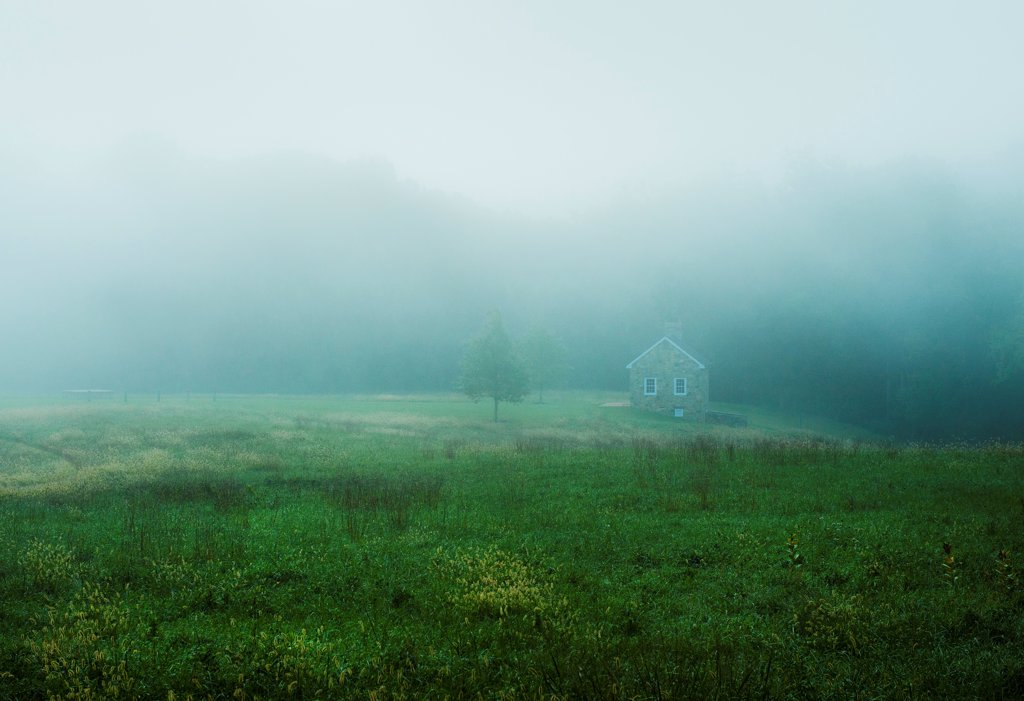 Stock Photo: 4282-36015 USA, Delaware, Ashland. A quaint stone cottage on a misty morning.