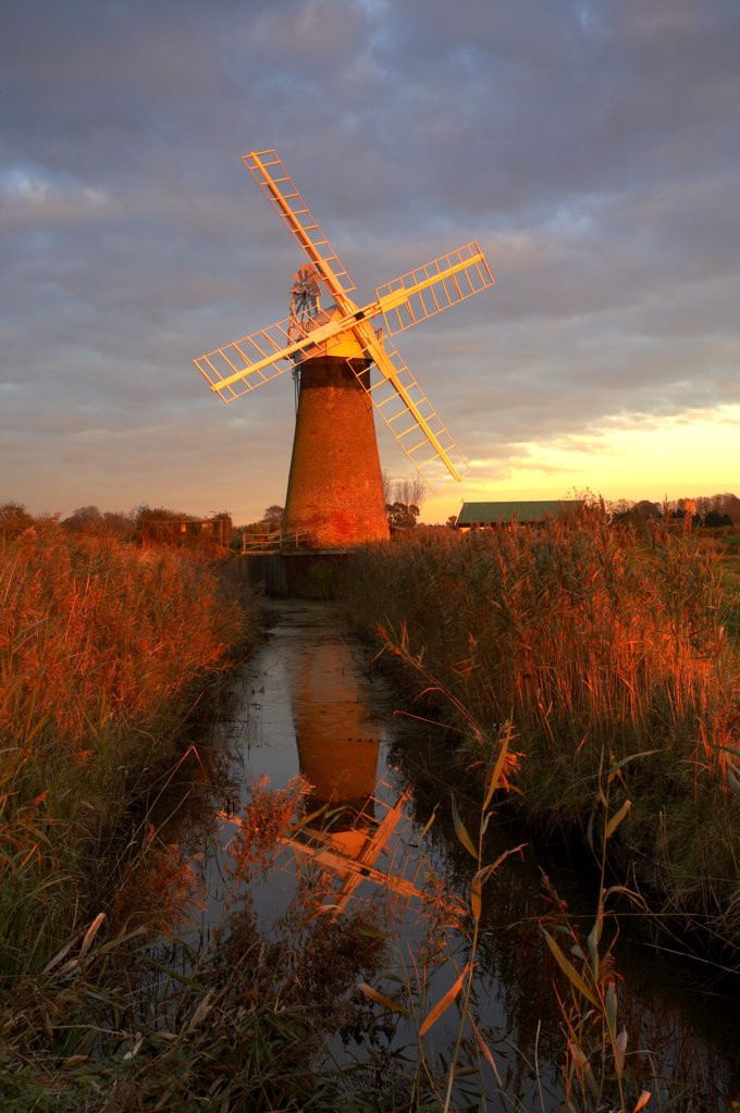 England, Norfolk, St. Benets Windmill. St. Benets Windmill at last light on the Norfolk Broads. : Stock Photo