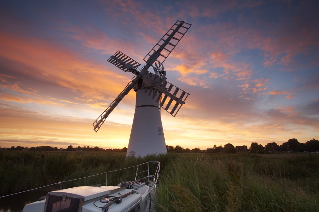 England, Norfolk, Thurne. Thurne Windmill at sunrise on the Norfolk Broads. : Stock Photo
