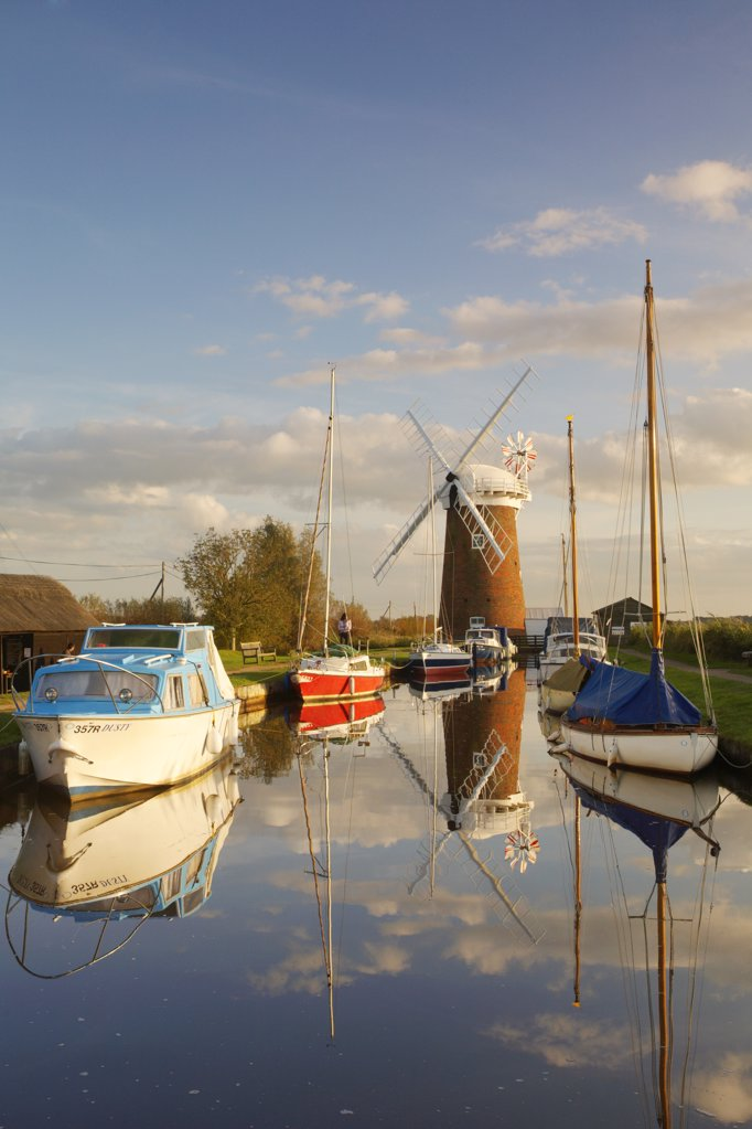 Stock Photo: 4282-3960 England, Norfolk, Brancaster Staithe. Horsey Windmill and boats moored at Brancaster Staithe in Norfolk.