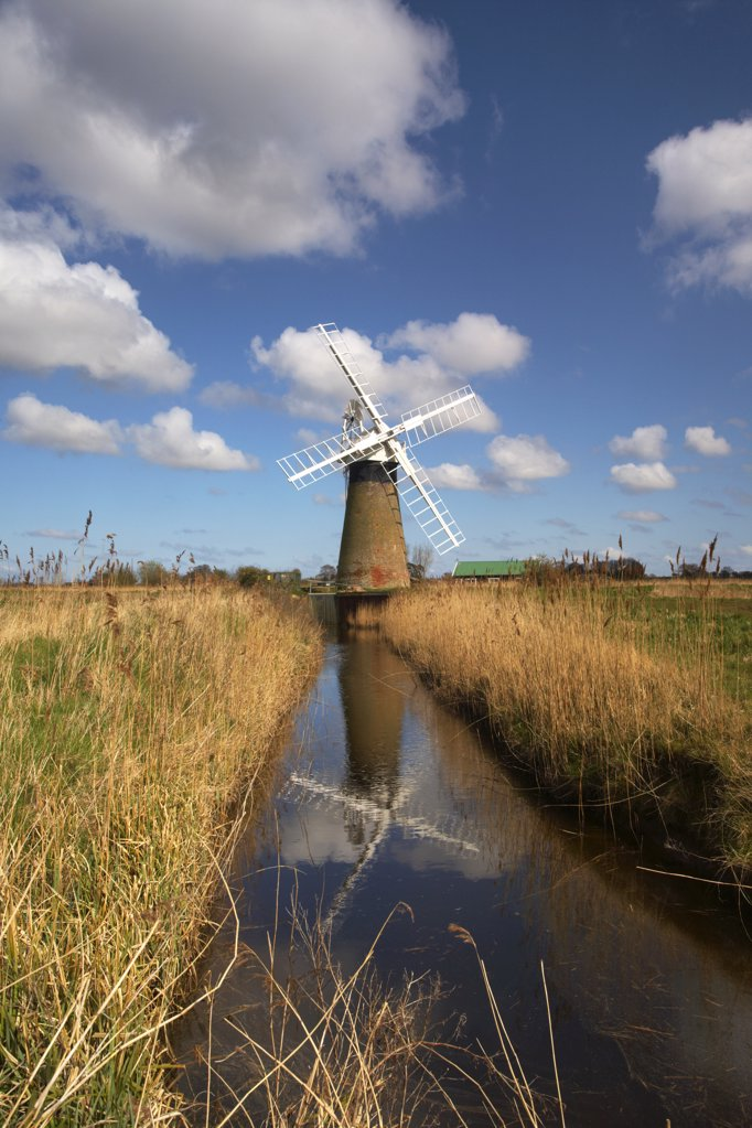 Stock Photo: 4282-3982 England, Norfolk, Thurne. Reflections in the water of St. Benets Level windpump on the Norfolk Broads.