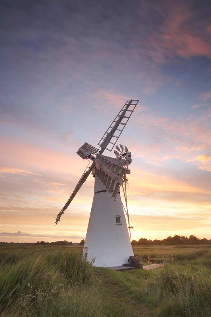 Stock Photo: 4282-3989 England, Norfolk, Thurne. Thurne windmill at sunrise on the Norfolk Broads.