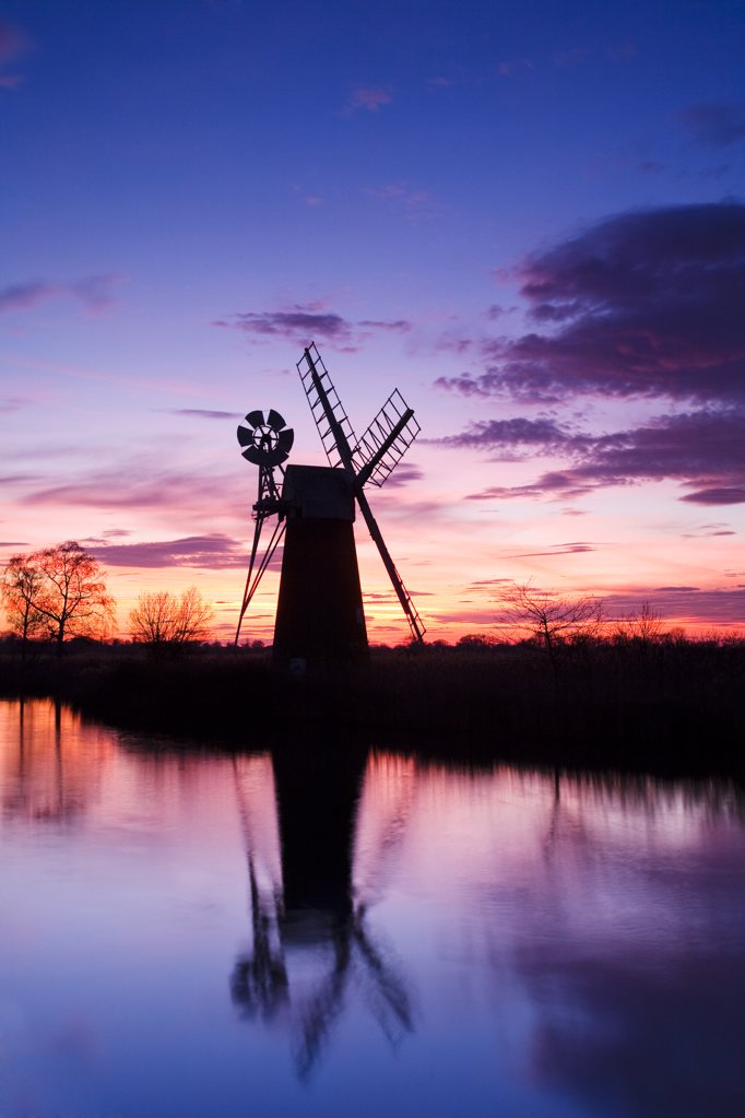 Stock Photo: 4282-4064 England, Norfolk, Near How Hill. Turf Fen drainage mill at sunset on the River Ant in the Norfolk Broads.