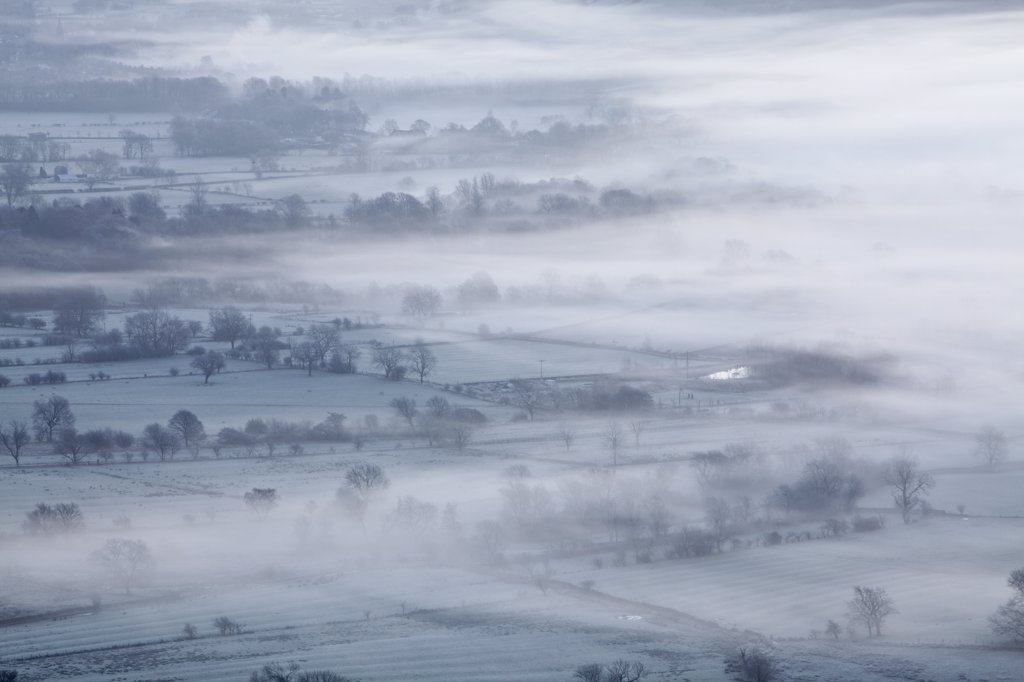 Stock Photo: 4282-4279 England, Derbyshire, Hope Valley. The Hope Valley shrouded in mist at dawn in the Peak District National Park.