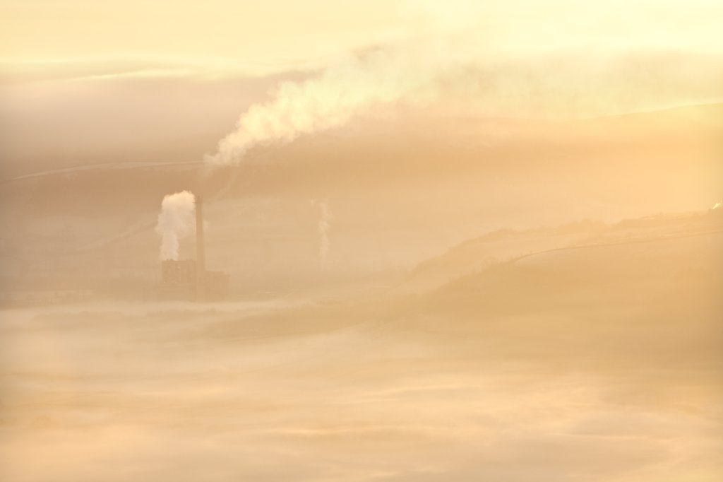 England, Derbyshire, Hope Valley. Hope Valley Cement Works shrouded in mist at sunrise in the Peak District National Park. : Stock Photo