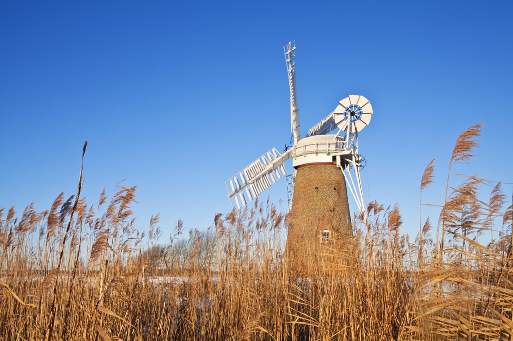 Stock Photo: 4282-4352 England, Norfolk, near Hardley Street. The newly restored Hardley Drainage Mill, originally built in 1874, on the Norfolk Broads.