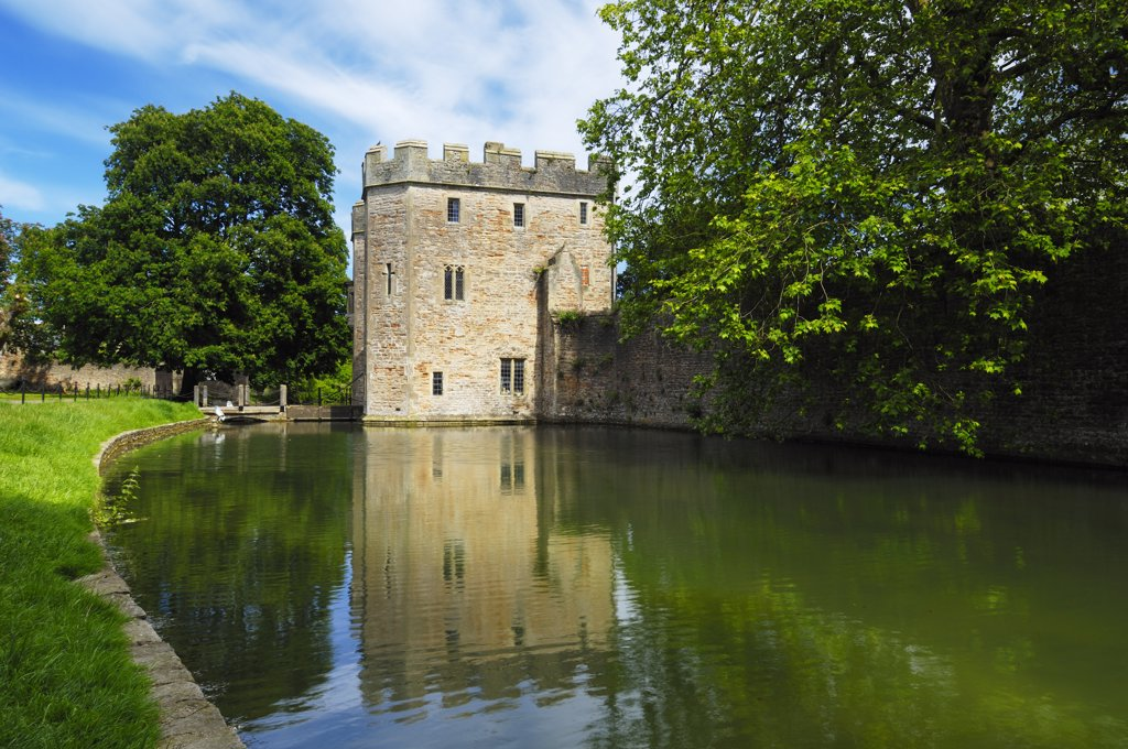 England, Somerset, Wells. The moat and outer wall around the Bishop's Palace and gardens. : Stock Photo