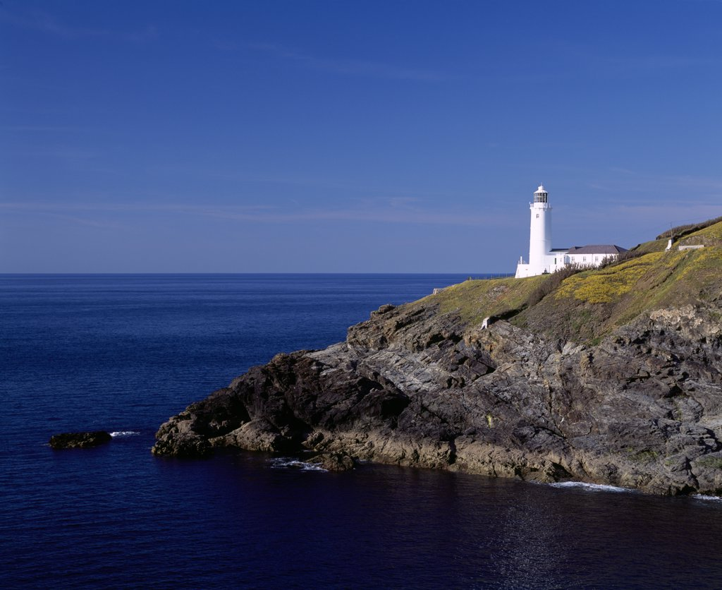 England, Cornwall, Trevose Head. Stinking Cove and the lighthouse at Trevose Head on the North Cornwall coast near Padstow. : Stock Photo