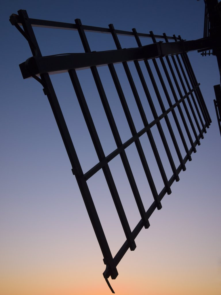 England, Somerset, Chapel Allerton. Silhouette at dusk of a sail on Ashton Windmill, a tower mill dating from the 18th century. : Stock Photo