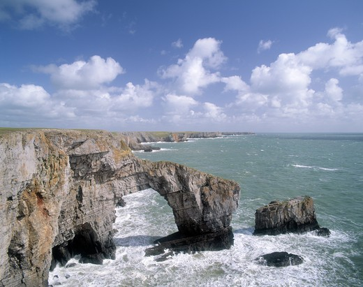 Wales, Pembrokeshire/ Sir Benfro, St Govan's. The Green Bridge of Wales, a spectacular natural arch at St Govans Headland on the Pembrokeshire coast. : Stock Photo