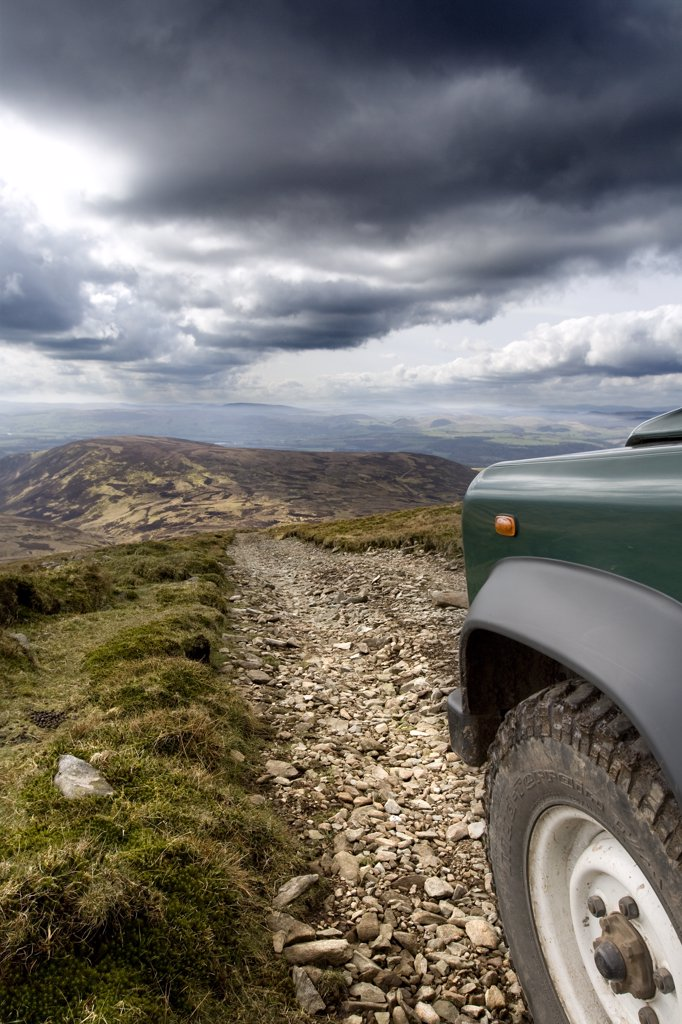 Stock Photo: 4282-6440 Scotland, Dumfries and Galloway, Drumlanrig. A Land Rover on a rough track in Drumlanrig Country Estate.