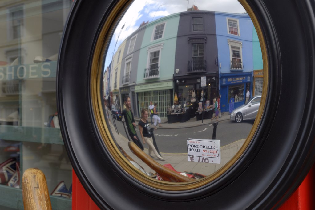 England, London, Notting Hill. Antique mirror in Portobello road with out-of-focus reflection of shoppers. : Stock Photo
