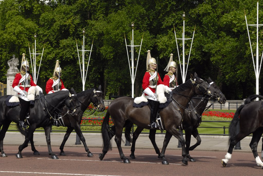 Stock Photo: 4282-7063 England, London, Buckingham Palace. Horse Guards riding along the Mall near Buckingham Palace.