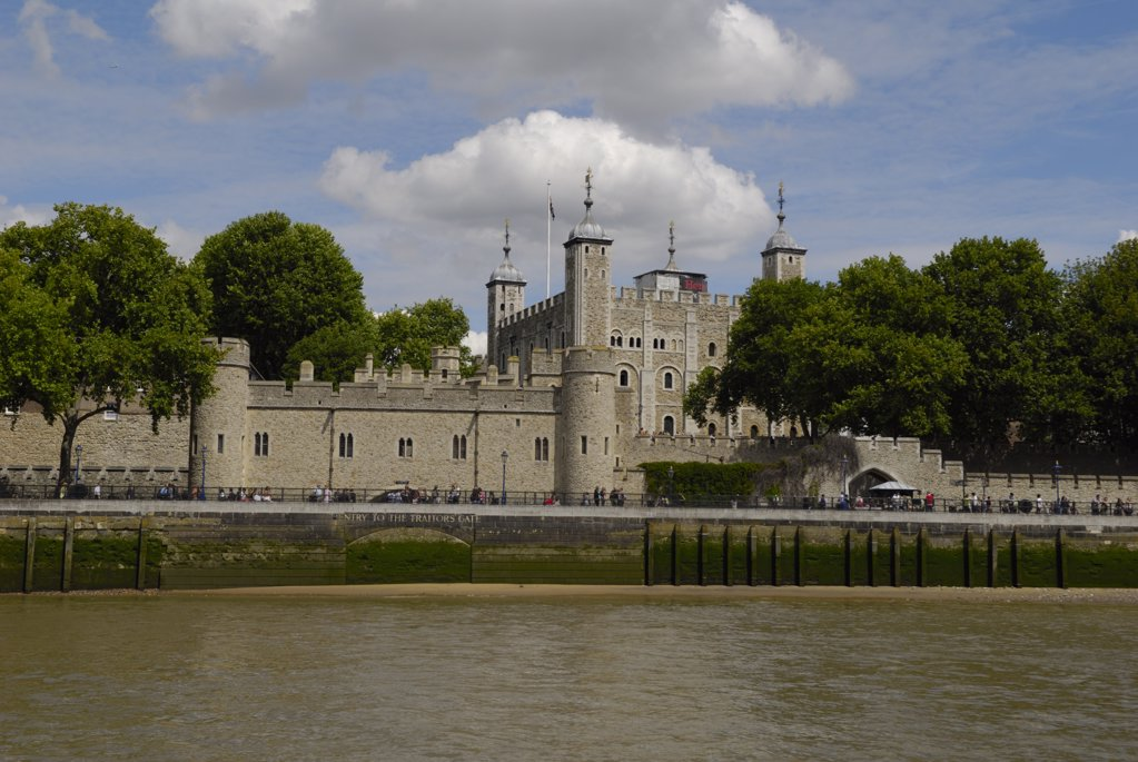 England, London, Tower of London. The Tower of London viewed from a boat on the River Thames. : Stock Photo