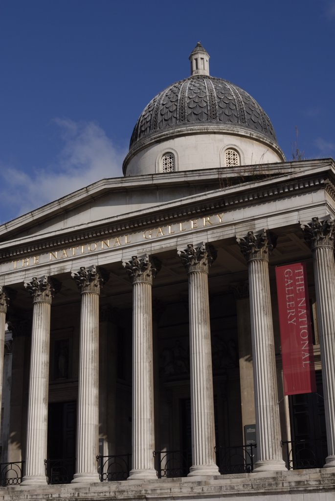 Stock Photo: 4282-7195 England, London, National Gallery. Front view of The National Gallery. The National Gallery was originally established in 1824 when 36 paintings were bought for the country from a banker, John Julius Angerstein.