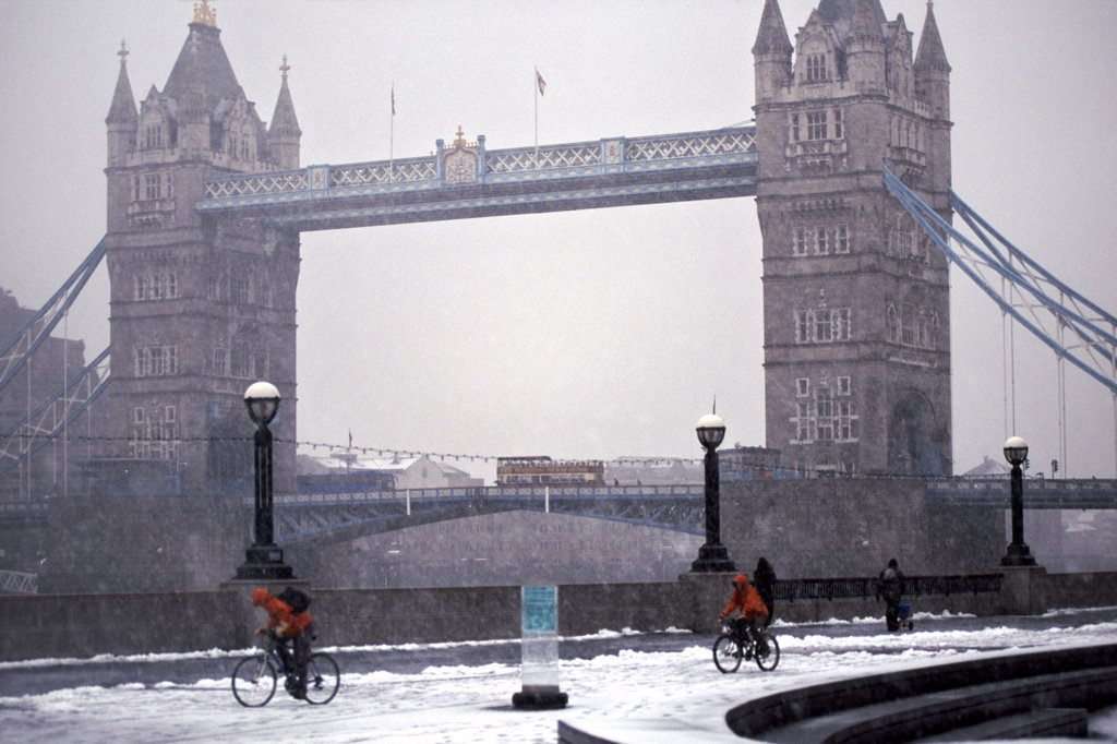 England, London, Tower Bridge. A view to Tower Bridge from the bank of the River Thames after a snowfall. : Stock Photo