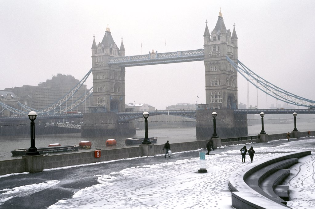 Stock Photo: 4282-7646 England, London, Tower Bridge. A view to Tower Bridge from the bank of the River Thames after a snowfall.