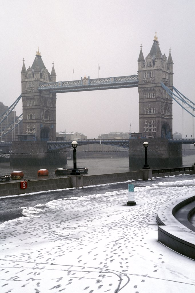 Stock Photo: 4282-7647 England, London, Tower Bridge. A view to Tower Bridge from the bank of the River Thames after a snowfall.