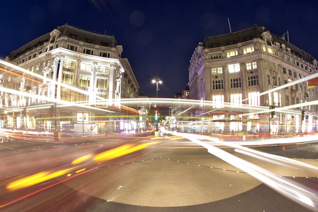 England, London, Oxford Circus. Light trails from traffic passing through Oxford Circus at night. : Stock Photo