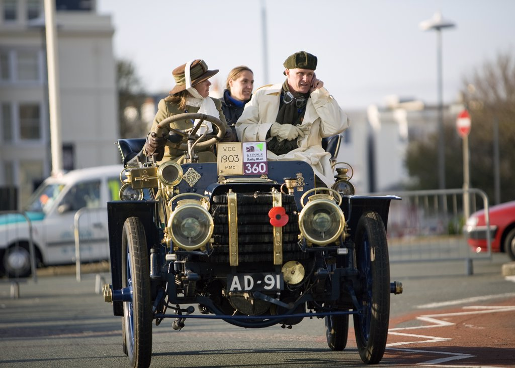 England, City of Brighton and Hove, Brighton. A participant on his mobile in the 2008 London to Brighton Veteran Car Run. : Stock Photo