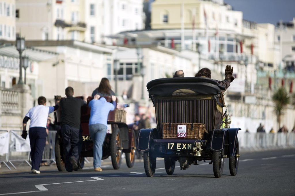 Stock Photo: 4282-7908 England, City of Brighton and Hove, Brighton. A car being pushed along as another overtakes in the 2008 London to Brighton Veteran Car Run.