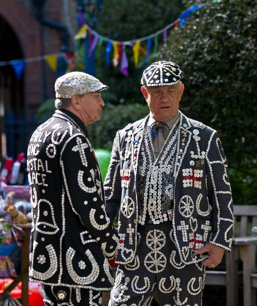 England, London, Covent Garden. The Pearly King of Highgate in conversation with the Pearly King of Crystal Palace. : Stock Photo