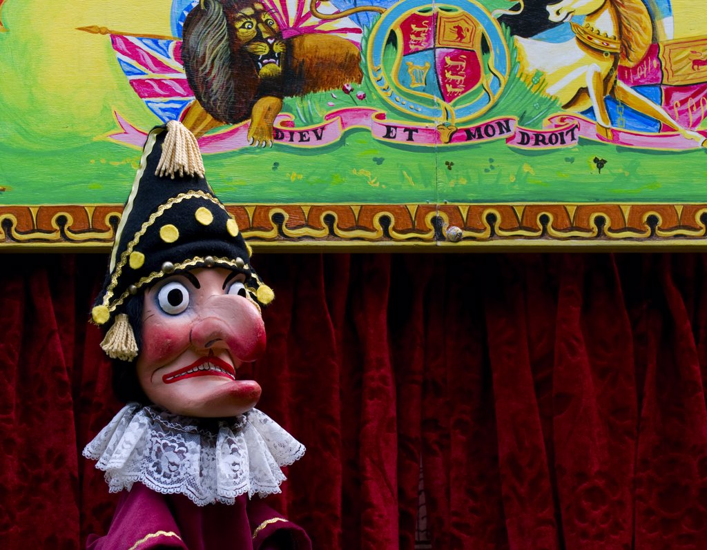 Stock Photo: 4282-8260 England, London, Covent Garden. Mr Punch puppet in a booth during a performance at the annual Punch and Judy festival in Covent Garden.