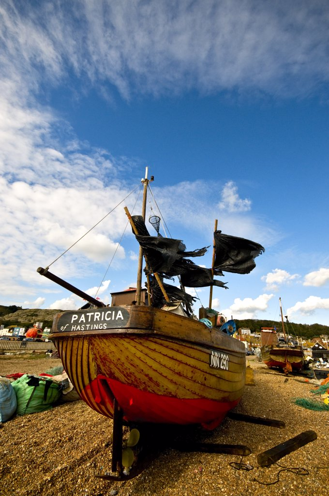 Stock Photo: 4282-8327 England, East Sussex, Hastings. Fishing boat beached on the Stade at Hastings.