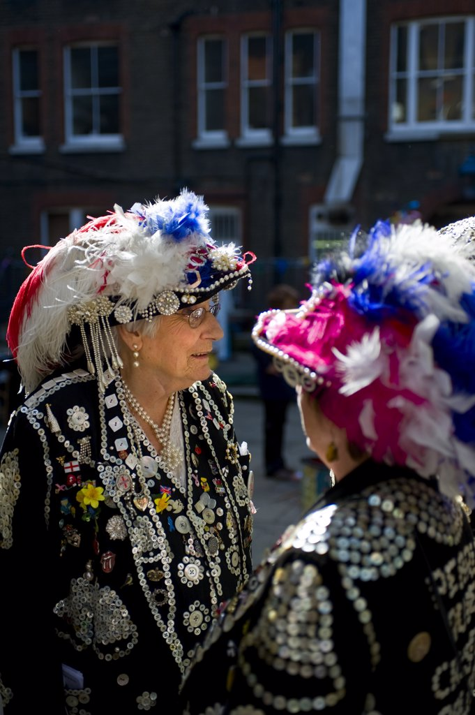 Stock Photo: 4282-8332 England, London, Covent Garden. Pearly Queens talking together in Covent Garden.