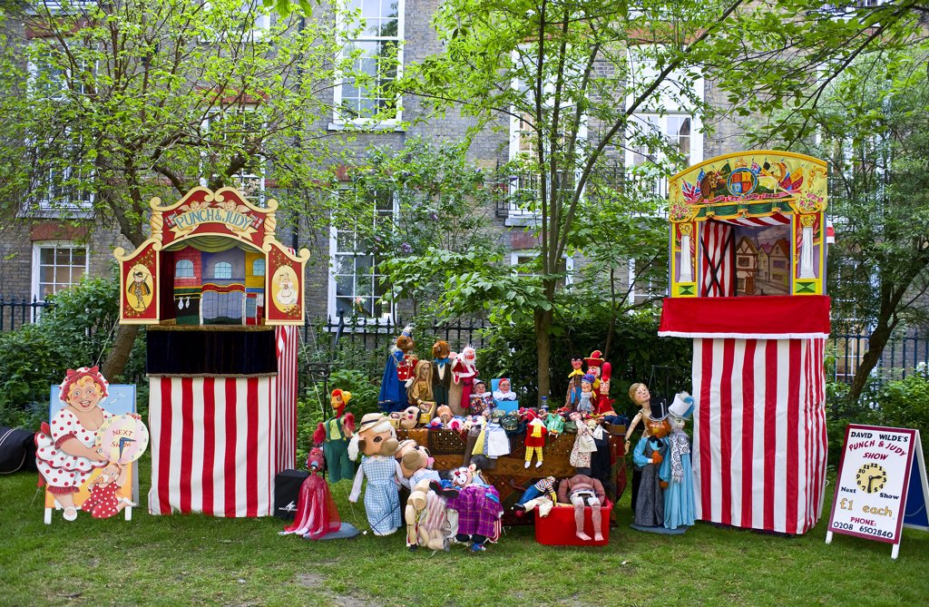 England, London, Covent Garden. Punch and Judy booths and puppets in the grounds of St Pauls Church at the annual Punch and Judy festival in Covent Garden. : Stock Photo