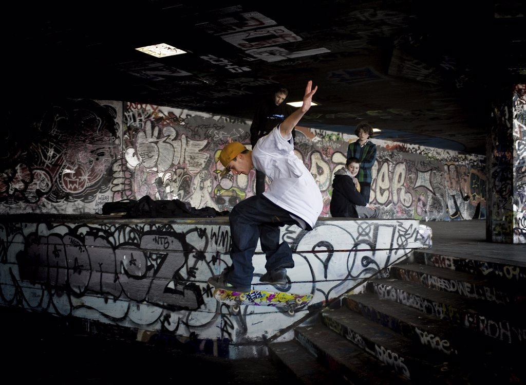 England, London, South Bank. A skateboarder performing a stunt at the undercroft on the South Bank. : Stock Photo