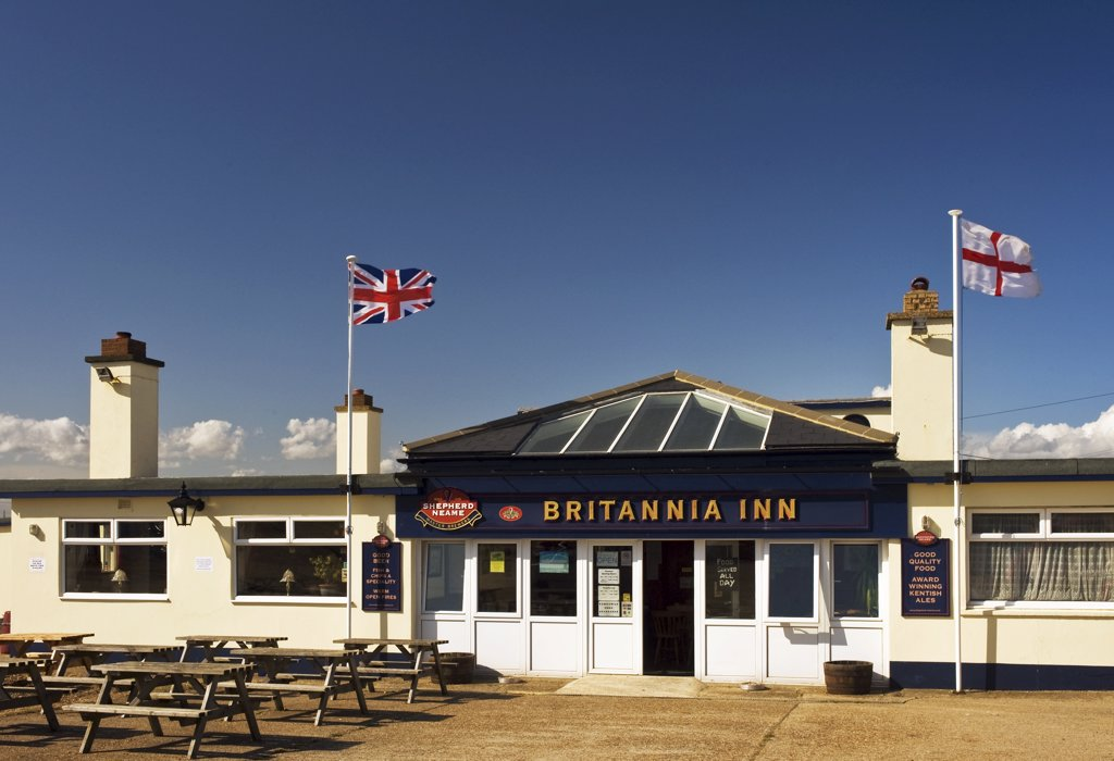 Stock Photo: 4282-8591 England, Kent, Dungeness. A Union and English flag flying outside The Britannia Inn public house in Dungeness.