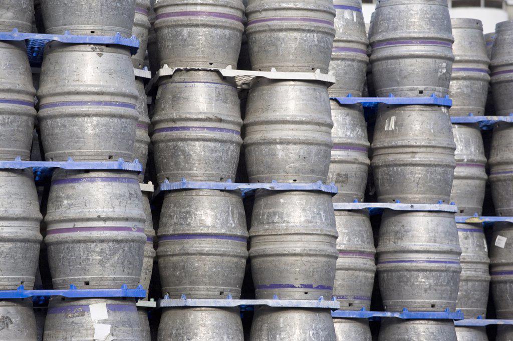 Stock Photo: 4282-9108 England, West Yorkshire, Leeds. Beer kegs stacked at the Carlsberg Tetley brewery in Leeds.