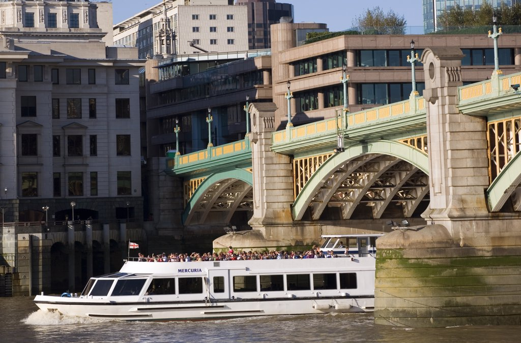 Stock Photo: 4282-9133 England, London, Southwark Bridge. A sightseeing boat passing under Southwark Bridge on the River Thames.