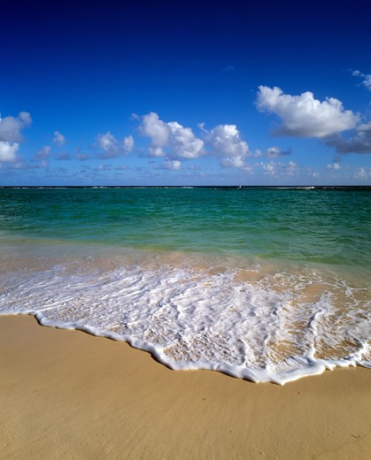 TROPICAL BEACH SEA AND CLOUDS GUADELOUPE FRENCH WEST INDIES : Stock Photo