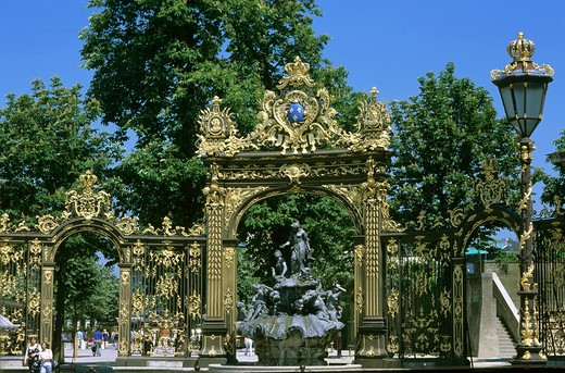 Stock Photo: 4285-10530 GILT WROUGHT-IRON RAILINGS AND STREET LAMP WITH AMPHITRITE FOUNTAIN BY GUIBAL PLACE STANISLAS SQUARE NANCY LORRAINE FRANCE
