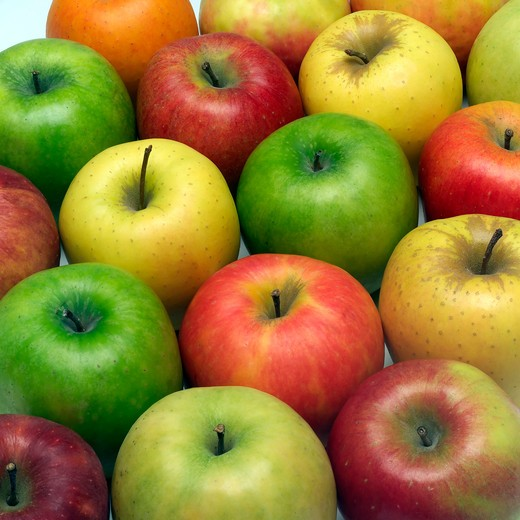 assortment of pink lady golden and granny smith apples : Stock Photo