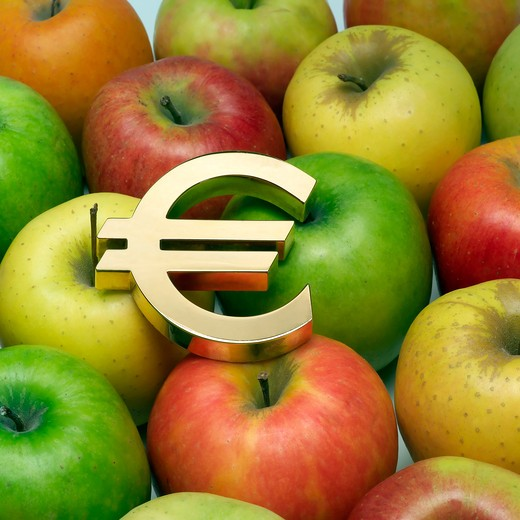 euro european currency sign and an assortment of apples : Stock Photo