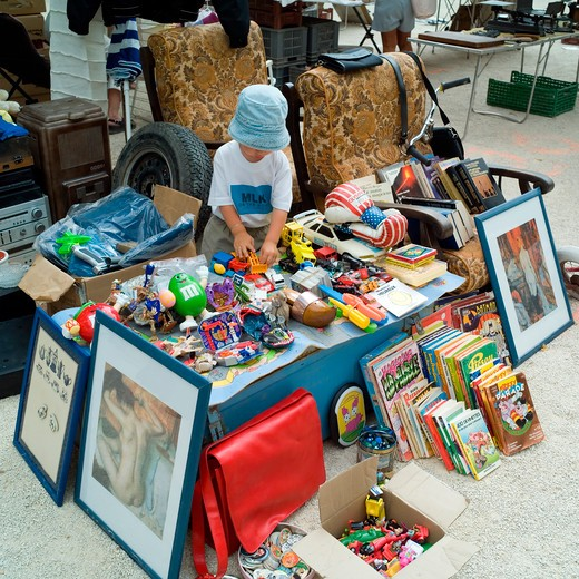 little boy and toys at annual flea market sault village provence france : Stock Photo
