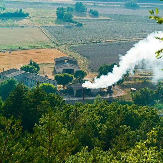 Stock Photo: 4285-11238 smoking chimney distillerie du vallon lavender oil distillery provence france