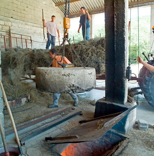 Stock Photo: 4285-11242 man moving the boiler's stone lid distillerie du vallon lavender oil distillery provence france