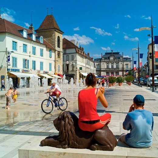 people at liberte square and fountains lons-le-saulnier jura france : Stock Photo