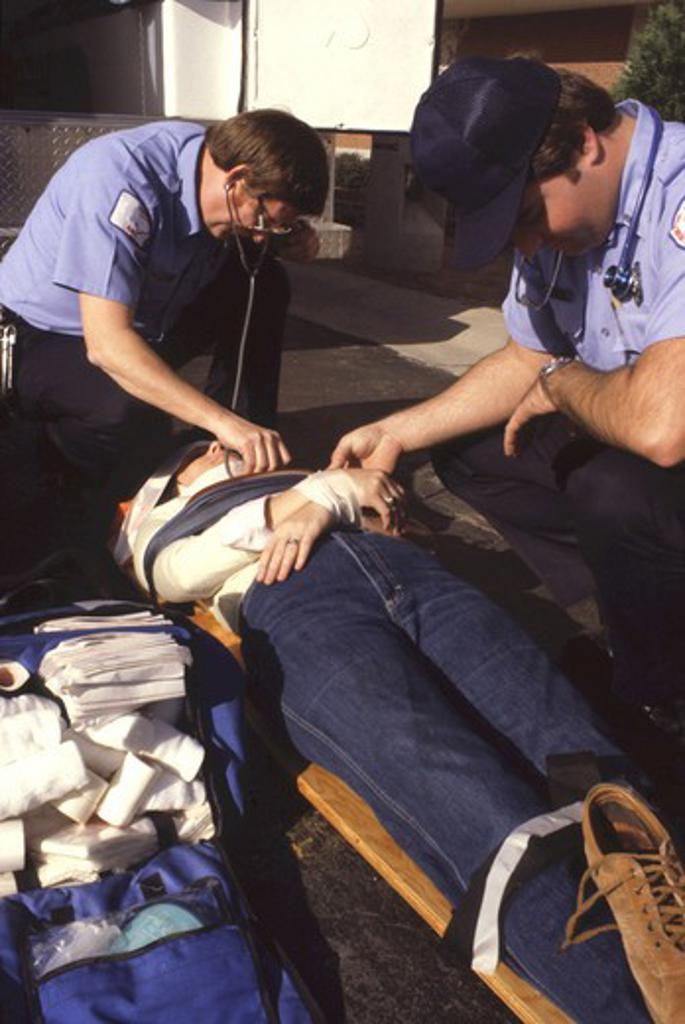 EMT crew training with volunteer patient. : Stock Photo