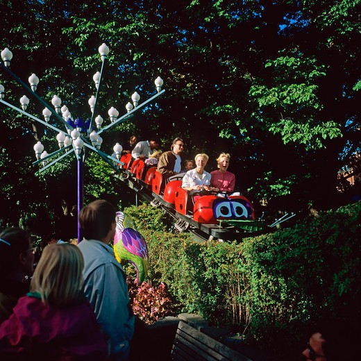 Stock Photo: 4285-11794 people on a roller coaster in tivoli amusement park copenhagen denmark