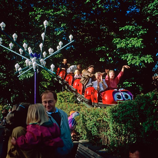 Stock Photo: 4285-11795 people on a roller coaster in tivoli amusement park copenhagen denmark