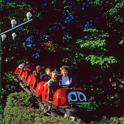 people on a roller coaster in tivoli amusement park copenhagen denmark : Stock Photo